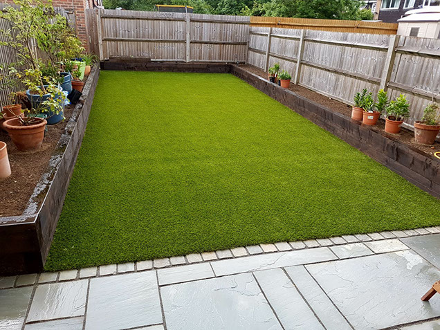 Turnford Artificial Grass Patio And Raised Sleeper Beds 7. Harlow Brick  Wall With Coping Stones And Resin Bonding